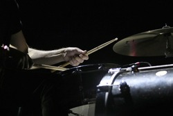 Hands of drummer with sticks
