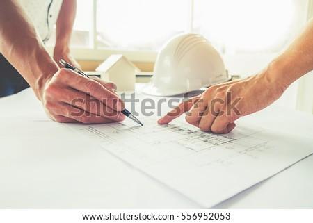 Hands of Engineer working on blueprint,Construction concept. Engineering tools. #556952053