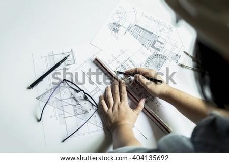 hands of engineer working on...