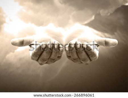 Hands of God concept: Jesus Christ open empty hands with palm up on heaven background.