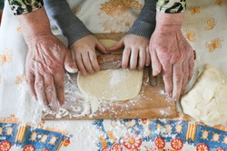 Hands of grandmother and grandson close up