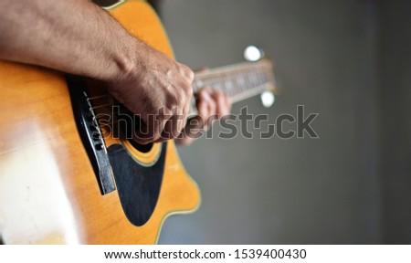 hands of guitarist on guitar