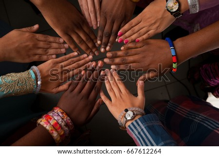 Hands of happy group of African people which stay together in circle happy