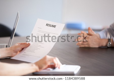 Hands of hr holding paper resume at job interview, recruiter or employer reading cv application of vacancy candidate during hiring negotiations, employment and staff recruiting concept, close up view