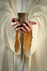 Hands of Jesus holding cup of wine