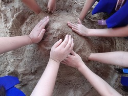 hands of kids playing sand