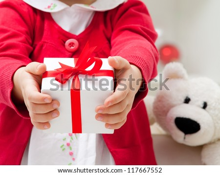 Hands of  little girl with Christmas present. unrecognizable