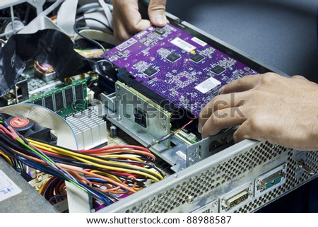 Hands of male fixing electronic device - stock photo