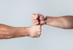 Hands of man people fist bump team teamwork, success. Man giving fist bump. Team concept. People bumping their fists together, arms. Friendly handshake, friends greeting. Two hands, isolated arm.