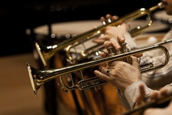 Hands of man playing the trumpet in the orchestra