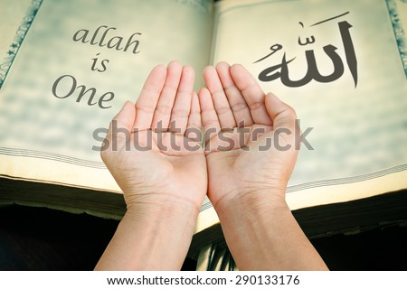 Hands of man praying to allah god of Islam.The words spell is Allah means the God of Islam.
