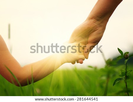 hands of mother and daughter...