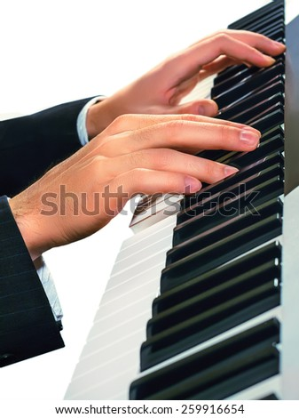 Hands of musician. Pianist playing on a synthesizer, isolated on a white background