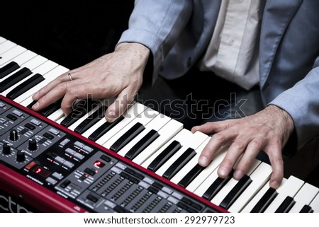 Hands of musician. Pianist playing on electric piano