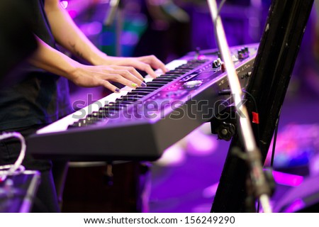 hands of musician playing keyboard in concert with shallow depth of field #156249290