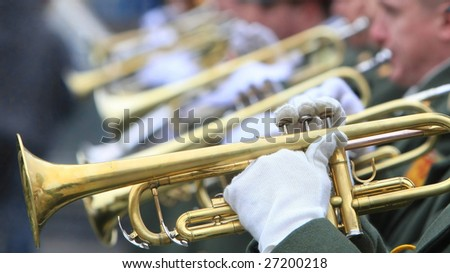 hands of musicians with trumpets (selective focus)