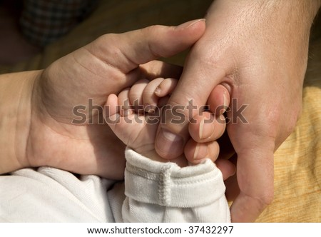 hands of parents and the baby
