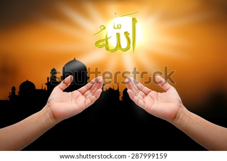 Hands of people praying to allah god of Islam on sunset.The words spell is Allah means the God of Islam.