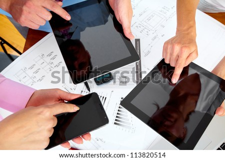 Hands of people working with tablet computer. Technology.