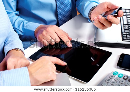 Hands of people working with tablet computer. Technology. #115235305