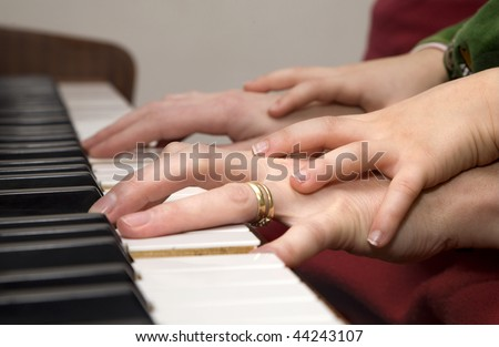 hands of piano player and the child