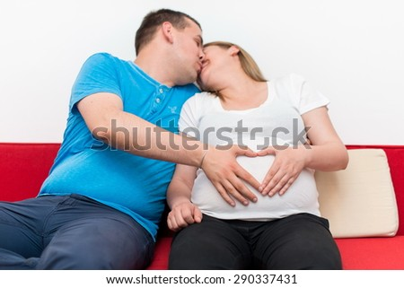 Hands of pregnant woman and her husband in heart shape #290337431