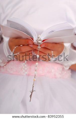 hands of prying girl going to the first holy communion