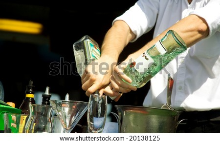 Hands of the barman mixing an alcoholic cocktail