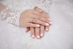 hands of the bride in a wedding dress, close-up
