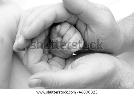 hands of the child in the hands of the father