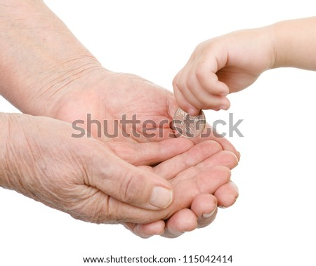 hands of the child put a coin in a palm of the old person. isolated on white background