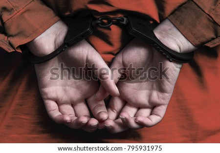 Hands of the girl in handcuffs. arrest. a crime. law. execution of sentences