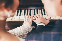 hands of the newlyweds play the piano wedding day, melody, rings
