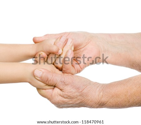 hands of the old man hold a hand of the baby. isolated on white background