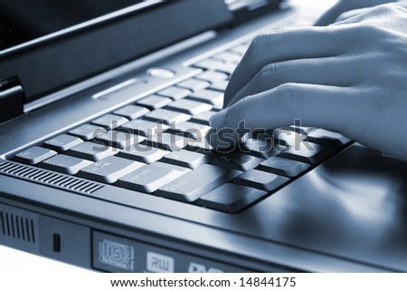 Hands of the woman on the keyboard of a laptop