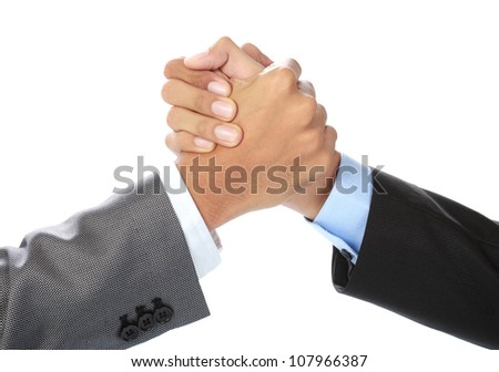 hands of two businessman holding each other