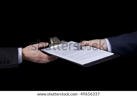 hands of two businessman passing some contract