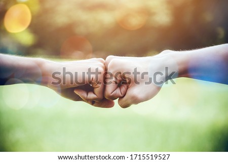 Hands of two man people fist bump team teamwork and partnership business success. Volunteer charity work. People joining for cooperation mergers and acquisitions concept