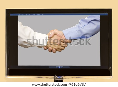 Hands of two White males shaking hands shown on LCD screen.