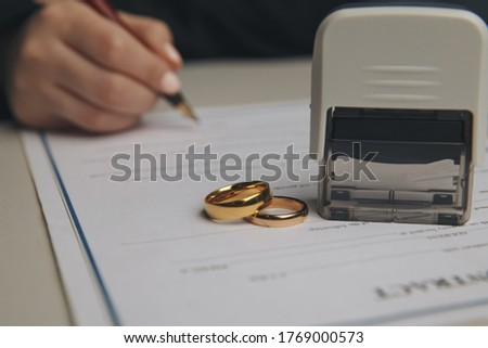 Hands of wife, husband signing decree of divorce, dissolution, canceling marriage, legal separation documents, filing divorce papers or premarital agreement prepared by lawyer. Wedding ring Сток-фото ©