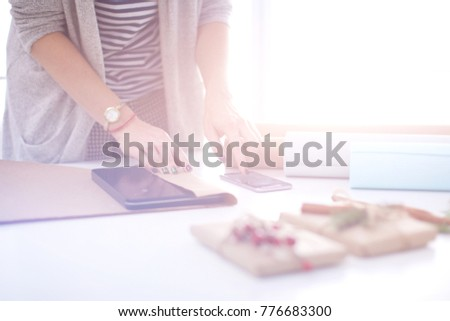 Hands of woman decorating christmas gift box. Hands of woman #776683300
