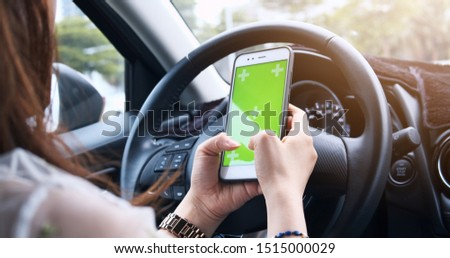 Hands Of Woman Using Using Smartphone With Green Screen Monitor At Interior