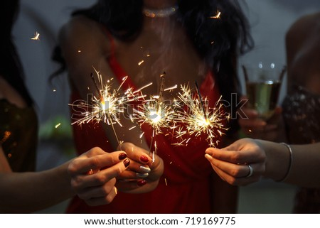 Hands of women holding Bengal light at the party #719169775