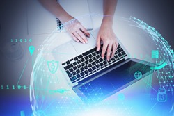 Hands of young woman using laptop in office with double exposure of creative big data interface. Concept of hi tech in education. Toned image