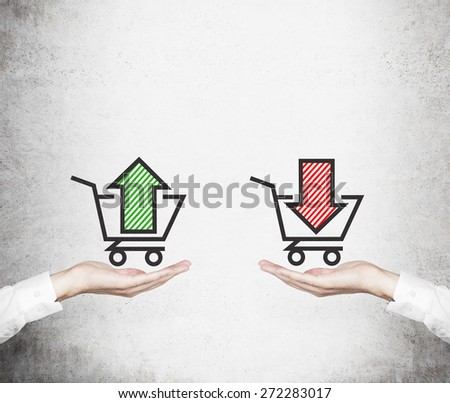 Hands offer the choice - \'sell or buy\'. Basket of goods. A concept of trading processes.