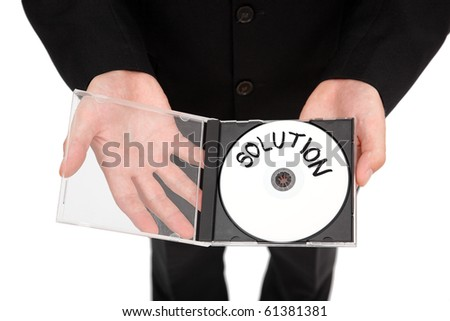 Hands offering a CD containing the solution