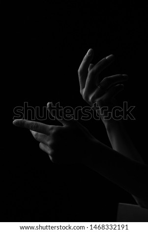 hands on a black background #1468332191