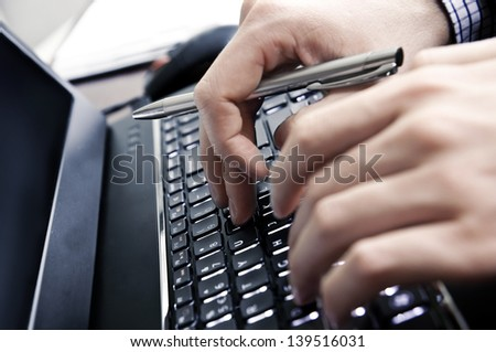 Hands on a laptop keyboard - a journalist, writer or a programmer at work