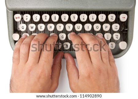 Hands on a typewriter keyboard on a white background