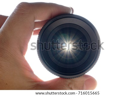 hands on camera lens and see the flare of sun #716015665